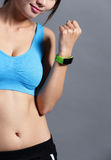 Sporting woman use wearable watch Stock Images