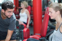 Sporting young couple in gym. Sporting a young couple in the gym Royalty Free Stock Photo