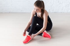 Sportive active girl lacing trainers sports shoes Stock Photos