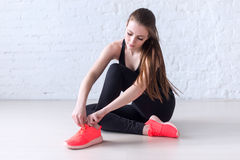 Sportive active girl lacing trainers sports shoes Royalty Free Stock Photos