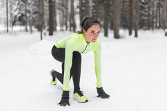 Sportive athlete woman sprinter ready to run waiting for the start running position fitness, sport, training Royalty Free Stock Photography
