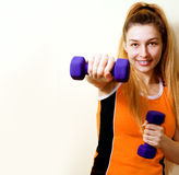 Sportive athletic woman working out with dumbbells Stock Photos