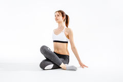 Sportive brunette doing stretching exercise stock image