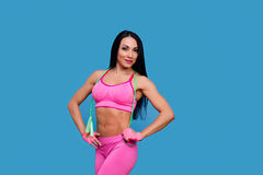 Sportive brunette girl in the pink sportswear with skipping rope Royalty Free Stock Photo