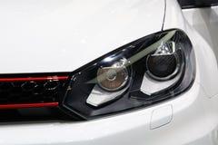 Sportive car headlight detail Royalty Free Stock Photos