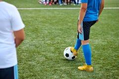 Sportive child boy kicking ball, penalty