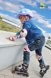 Sportive childhood  on inline skates Stock Images