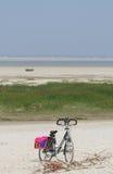 Sportive coast. Bike parked along the Dutch Northsea beach Stock Photography