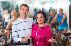 Sportive couple in a fitness club with friends Stock Photos