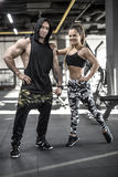 Sportive couple in gym Stock Images