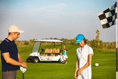 Sportive family playing golf on a golf course Stock Photo