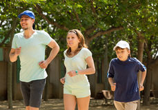Sportive family with son running in park Royalty Free Stock Photography