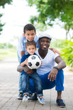 Sportive family. Vertical portrait of a modern sportive family posing at camera royalty free stock photo