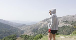 Sportive female boxer on top of mountain stock footage