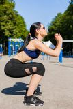 Sportive female on sport playground Stock Photos