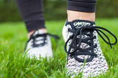 Sportive female training shoes Royalty Free Stock Photo