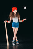 Sportive girl with baseball equipment isolated on black Royalty Free Stock Images