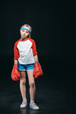Sportive girl in boxing gloves isolated on black Stock Photography