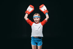 Sportive girl in boxing gloves isolated on black Stock Image