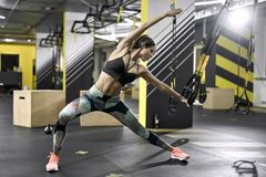 Sportive girl does exercise in gym Stock Photo