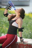 Sportive girl drinking Royalty Free Stock Images