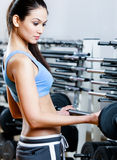 Sportive girl with dumbbells Royalty Free Stock Photography