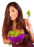 Sportive girl eating fresh salad Stock Image