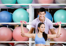 Sportive girl exercises in fitness gym Royalty Free Stock Image