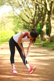 Sportive girl exercising outdoor in summer park Stock Photo