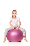 Sportive girl on a fit ball Stock Images