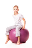 Sportive girl on a fit ball Royalty Free Stock Photography