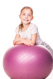 Sportive girl on a fit ball Stock Photography
