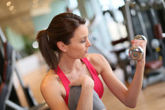 Sportive girl in a fitness club Royalty Free Stock Photography