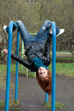Sportive girl hanging on horizontal bar Stock Photography