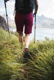 Sportive Girl Hiking. Adventurous Sportive Girl hiking at a Lake in Beautiful Alpine Mountains stock image