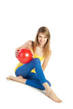 Sportive girl with red ball Royalty Free Stock Images