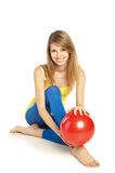 Sportive girl with red ball Royalty Free Stock Image