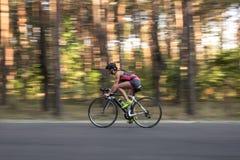 Sportive girl rides a bike Stock Photo