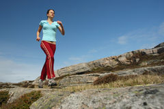 Sportive girl running outdoor. Sportive young woman running outdoor Royalty Free Stock Photography
