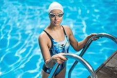 Sportive girl in the swim pool Stock Photo