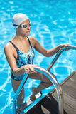 Sportive girl in the swim pool Royalty Free Stock Images