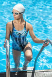 Sportive girl in the swim pool Stock Photos
