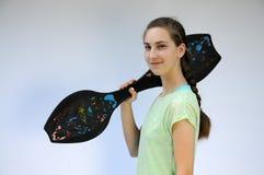 Sportive girl. Sportive teenager girl with waveboard Stock Photography