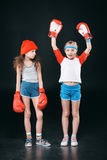 Sportive girls in boxing gloves isolated on black Stock Photo