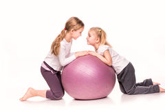 Sportive girls on a fit ball isolated over white Royalty Free Stock Image