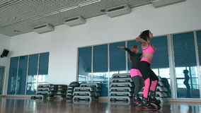 Sportive girls jumping in kangoo shoes in the gym stock video footage