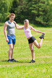 Sportive happy couple in meadows sunny day Royalty Free Stock Photography
