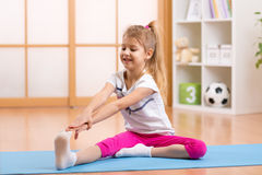 Sportive kid doing gymnastic at home Stock Images