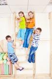 Sportive kids. Climbing on wall bars Royalty Free Stock Photo