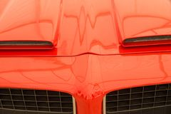Air intake of a vintage car. Sportive looking air intake on the hood of a vintage car Royalty Free Stock Images